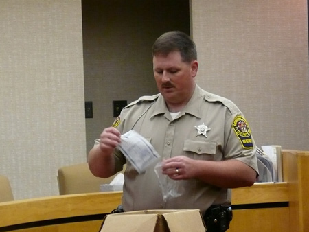 Deputy Cranor take s piece of paper out of baggy