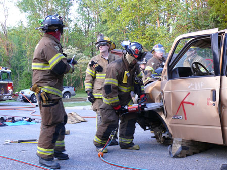 Firefighters use jaws of life during training