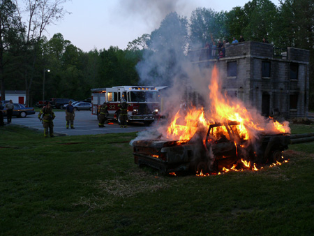 Goochland firefighters prepare to extinguish a veh