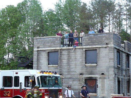 Students and families watch as the fire department