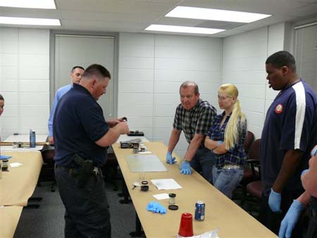 Deputy Chris Cranor demonstrates fingerprint techn