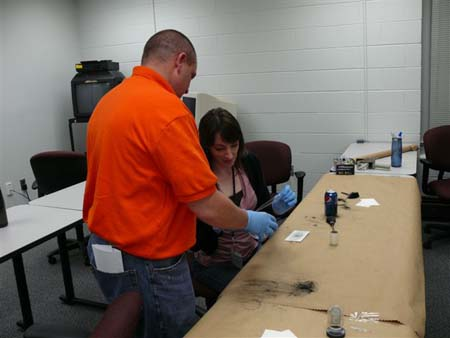 Students practice the art of fingerprinting