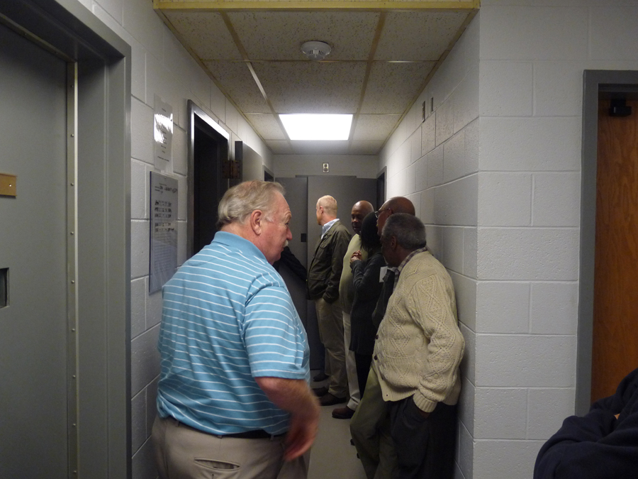 People stand in hallway during tour